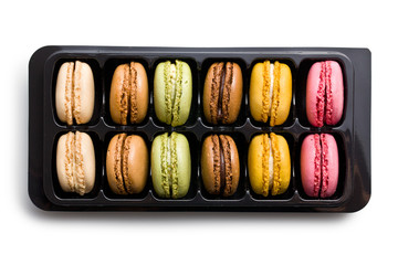 colorful macaroons in plastick box