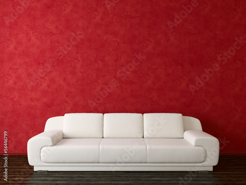 White sofa on red wall background