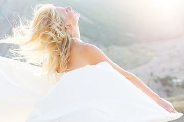 Beautiful bride posing on the mountain