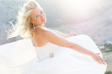 Beautiful bride posing on the mountain