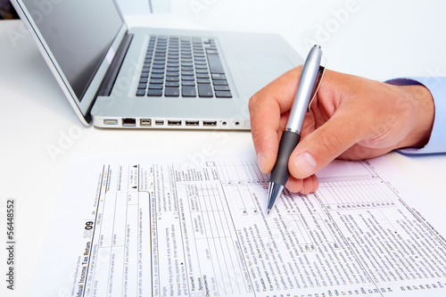Businessman filling the form.