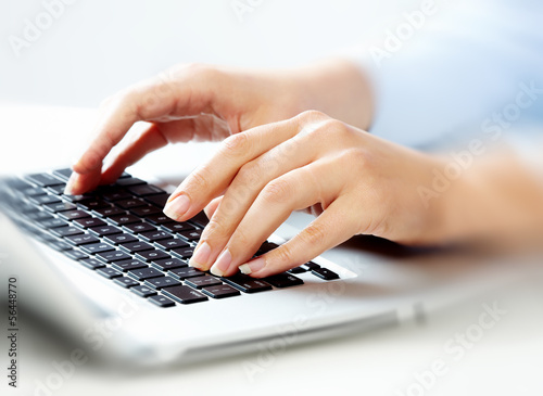 Hands with laptop computer keyboard.
