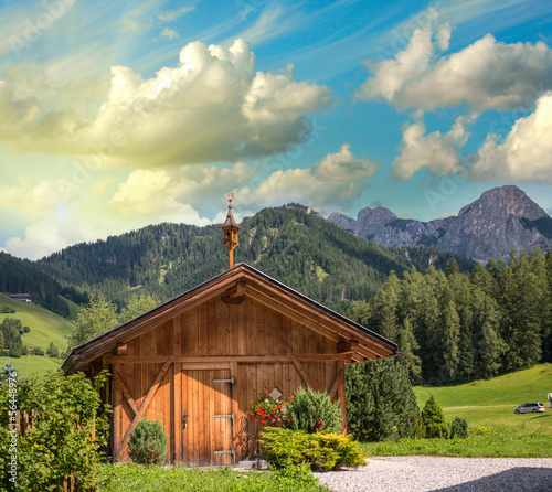 Mountain landscape - Isolated Hut on peaks background