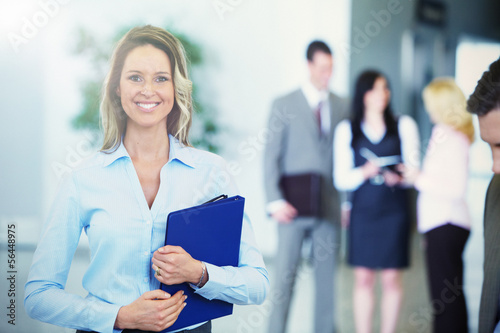 Bussinesswoman over team background