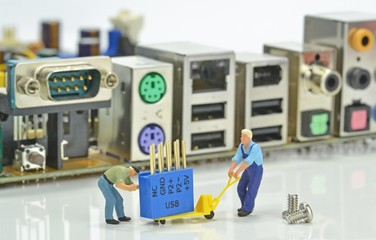 Computer repairs concept with mini figures and components