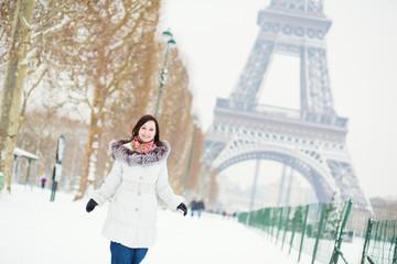 Girl enjoying beautiful winter day in Paris
