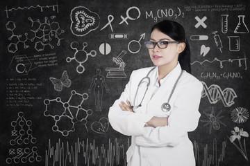 Beautiful doctor with written formula