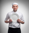 Male chef with plate isolated on white