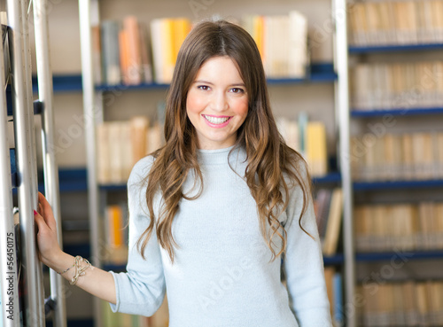 Beautiful student in a library