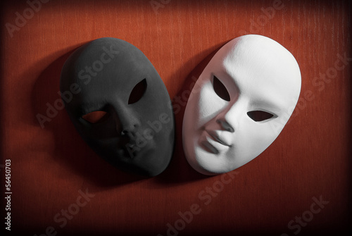 Black and white carnival mask on a wooden background - 56450703