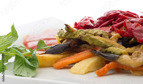 Stir fried vegetables isolated on white background