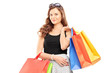 Attractive young woman posing with shopping bags