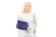 Blond female patient in hospital gown with broken arm and crutch