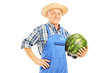 Smiling farmer holding a watermelon