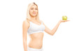 Young beautiful woman in white cotton underwear holding apple