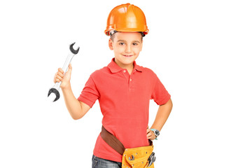 Child with helmet holding a wrench