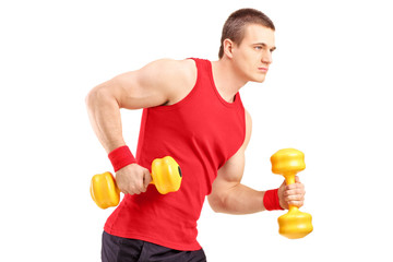 Muscular athletic man lifting dumbbells