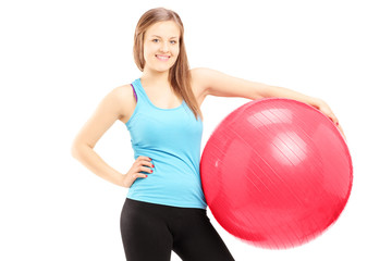 Young female athlete holding a fitness ball