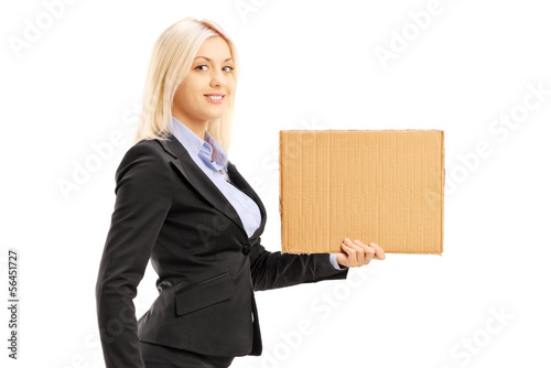 Blond woman in suit holding a piece of cardboard
