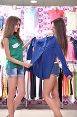 Two beautiful young woman in shop