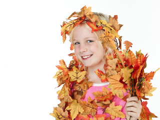 Cute girl with leaves in autumn