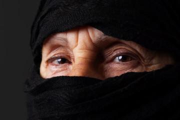 Senior muslim woman eyes staring