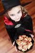 Halloween, girl with cookies has a fun at Halloween