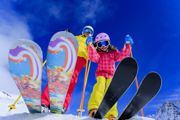 Ski, snow, sun and fun - skiers enjoying winter