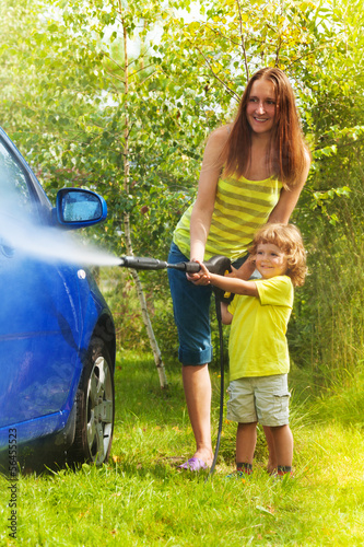Mother and son washes the car