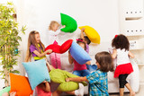 Fototapety Kids playing pillow fight