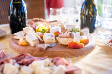 Cheese, salami, prosciutto and fruits as appetizer