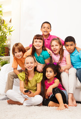 Group of kids with TV remote controll