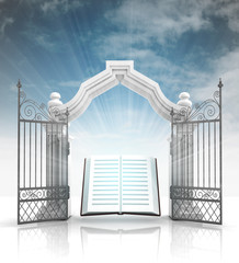 open baroque gate with holy bible and sky