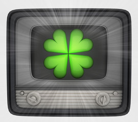 green cloverleaf in retro television and flare