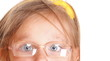 poor eyesight girl wearing glasses isolated on white