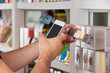 Man's Hand With Cellphone Scanning Product