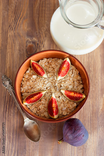 Bowl of oat flakes with milk and figs