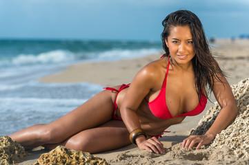 Sensual woman on the beach very happy