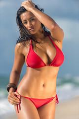Woman in the beach posing sensual