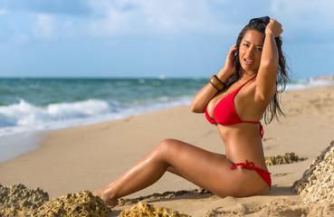 Happy brunette sunbathing