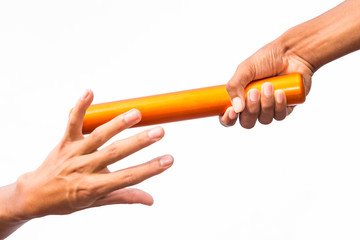 two hands passing a relay baton