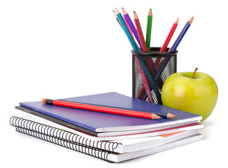 Notebook stack and pencils. Schoolchild and student studies acce
