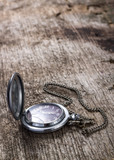 Old pocket watch on wood background with copyspace