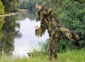 Commando in ghillie suit trains