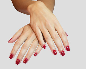 Young woman hands with red manicure