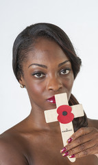 Black woman with Remembrance cross & poppy
