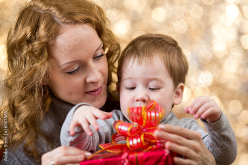 mother and son with gift