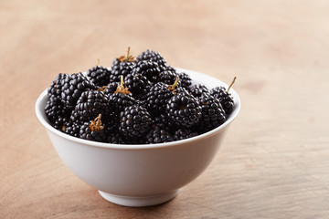 Bowl of blackberries on table