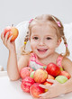 happy little girl with apple