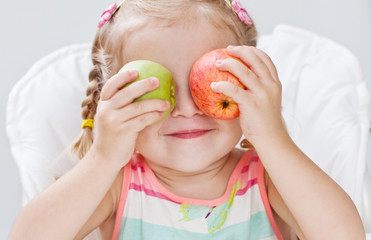 cute toddler girl with apples